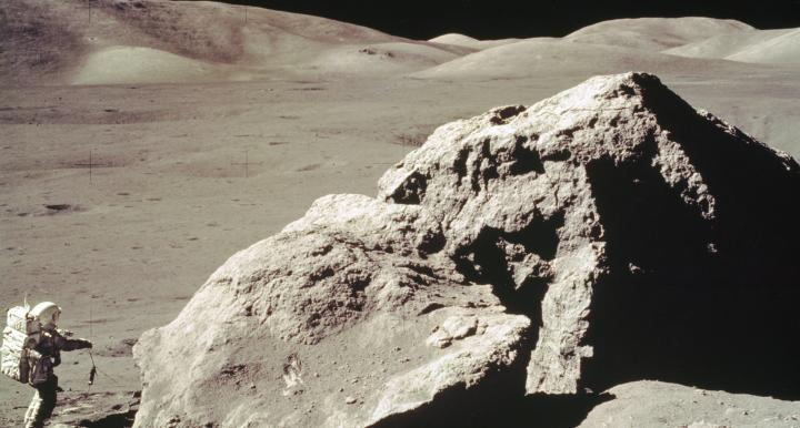 In this Apollo 17 onboard photo, scientist and astronaut Harrison H. Schmitt collects rock samples from a huge boulder near the Valley of Tourus-Littrow on the lunar surface. (Photo: NASA)